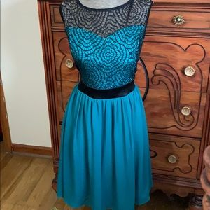 Teal dress with lace accents
